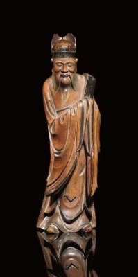 A CARVED WOOD FIGURE OF A DIGN