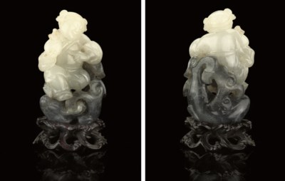 A WHITE AND GREY JADE CARVING