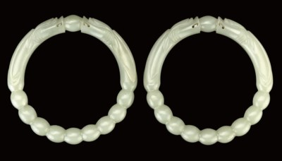A PAIR OF CELADON JADE BANGLES