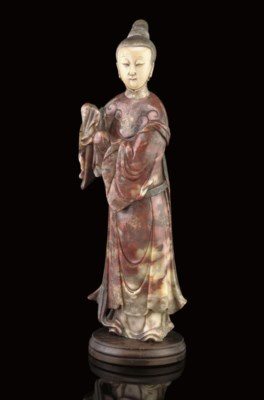 A LARGE SOAPSTONE CARVING OF A
