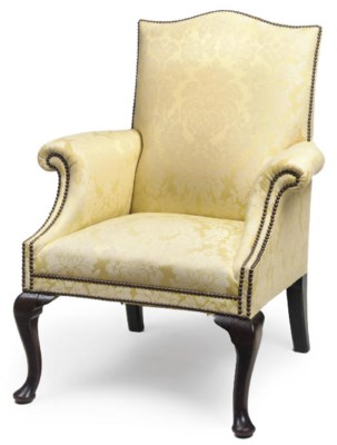 A YELLOW UPHOLSTERED ARMCHAIR
