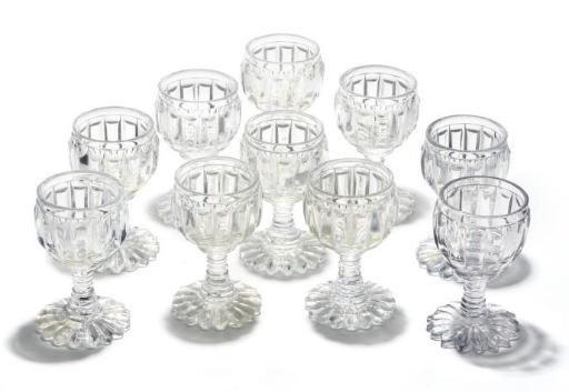 A SET OF TEN CUT-GLASS WINE GL