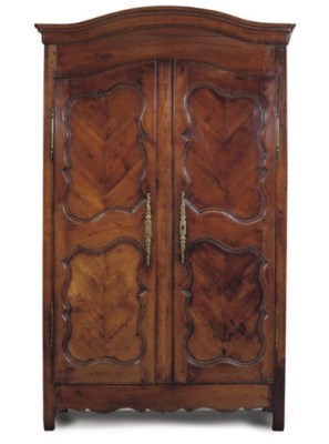 A FRENCH CHERRYWOOD ARMOIRE