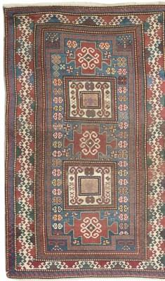 An antique Karachopf rug & Les