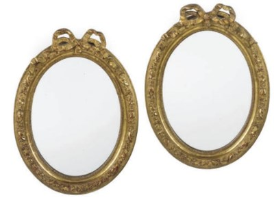 A PAIR OF OVAL GILT MIRRORS