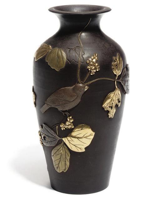 A Japanese iron vase