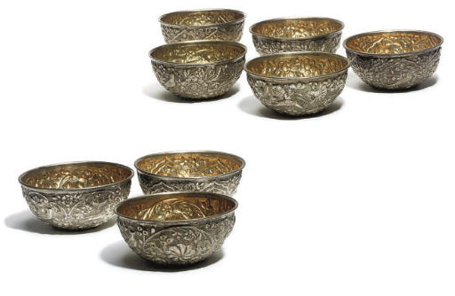 A Set of eight Indian repoussé