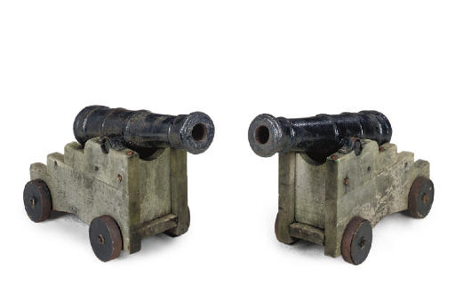 A PAIR OF CAST IRON CANNON