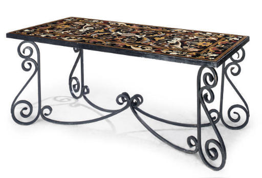 A WROUGHT IRON TABLE WITH INLA