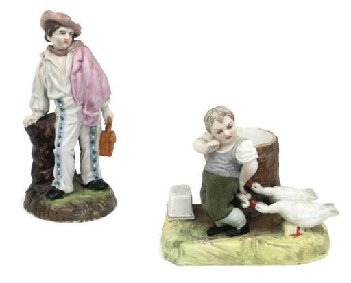 A RUSSIAN (GARDNER) BISCUIT PORCELAIN FIGURAL SPILL-VASE AND A PORCELAIN FIGURE OF A BOY