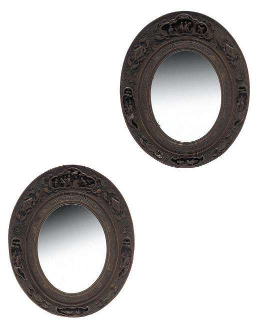 A pair of Chinese wood framed oval mirrors