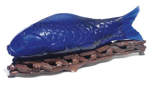 A blue glass model of a carp