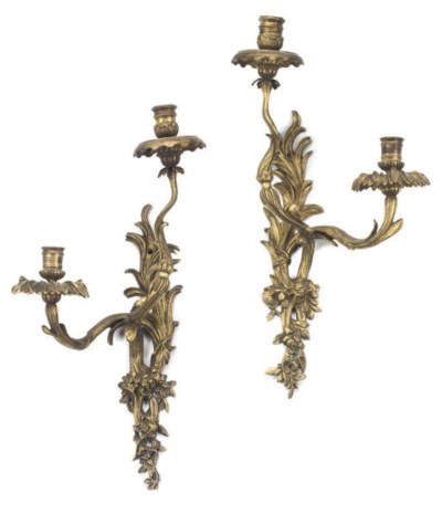A SET OF FOUR GILT BRASS WALL
