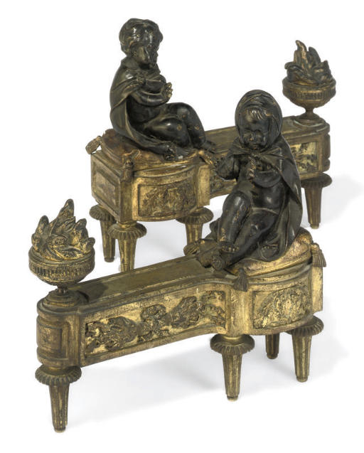 A PAIR OF PATINATED AND GILT-B