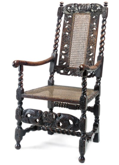AN ENGLISH OAK CANED ARMCHAIR