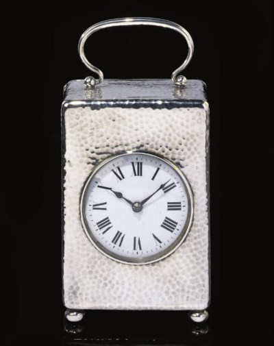 AN ENGLISH SILVER DESK TIMEPIE