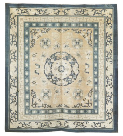 An antique Peking large rug