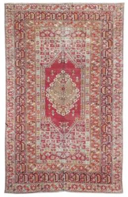An antique Ghiordes large rug