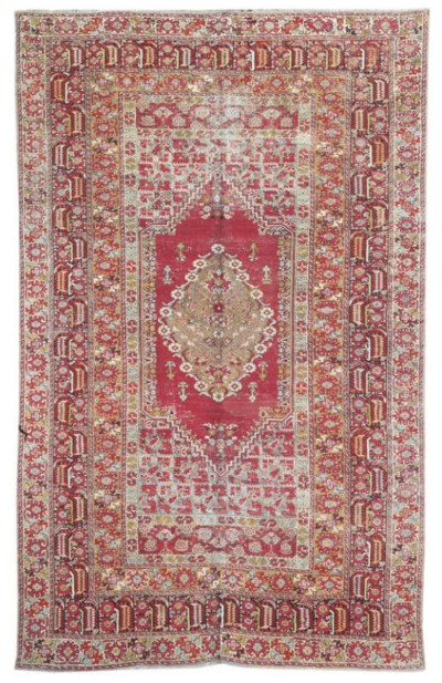 An antique Ghiordes large rug