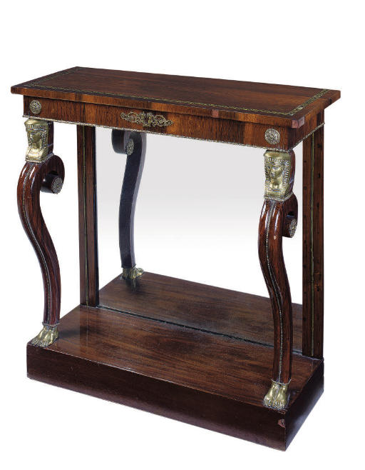 A REGENCY ROSEWOOD AND BRASS INLAID CONSOLE TABLE