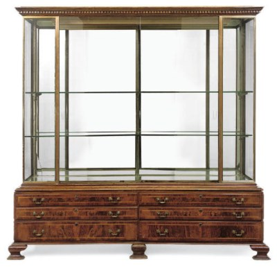 A BURR WALNUT DISPLAY CABINET