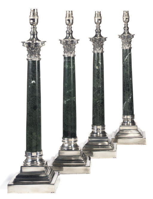 A SET OF FOUR SILVER-PLATED AN