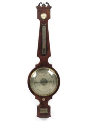 A Victorian mahogany wheel bar