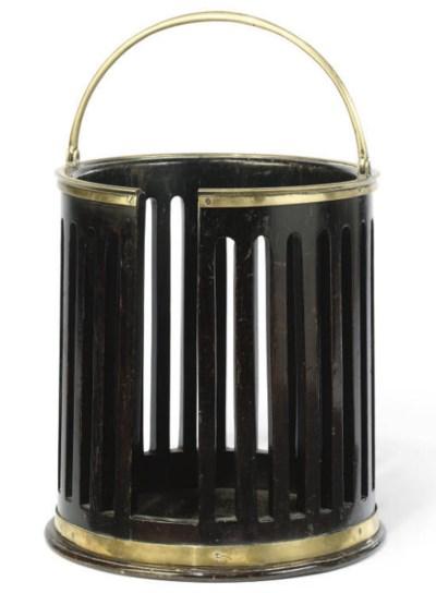 A BRASS MOUNTED MAHOGANY PLATE