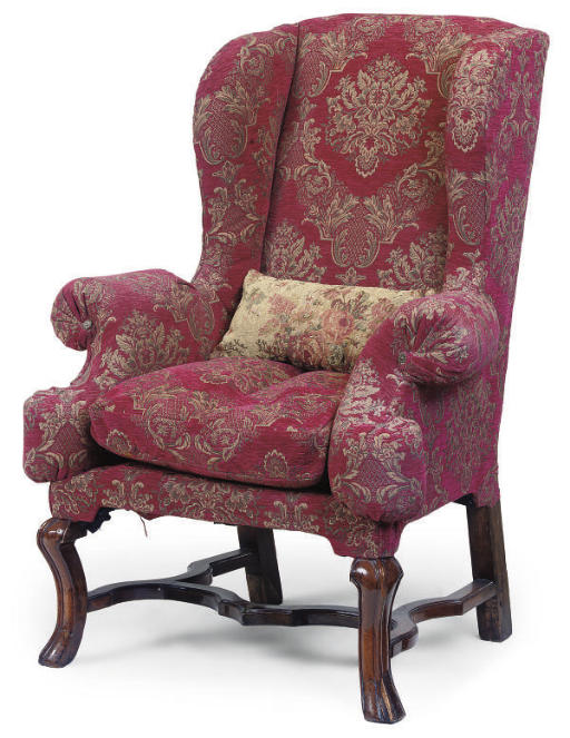 A WALNUT-FRAMED WING ARMCHAIR