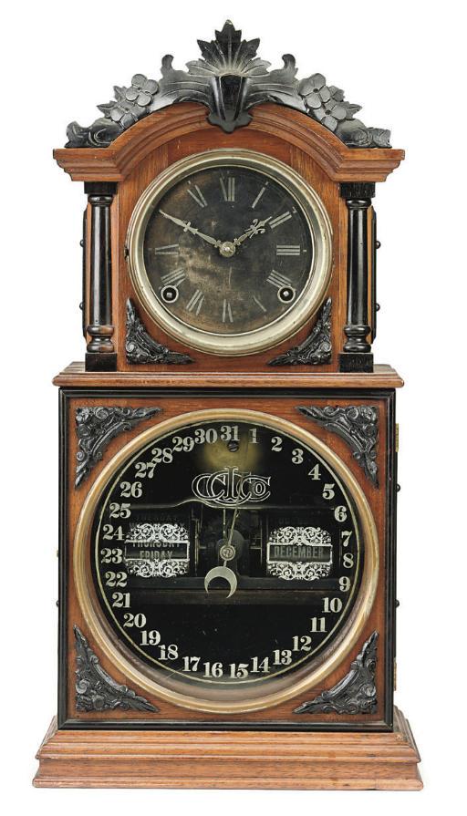 An American ebonised and walnut perpetual calendar mantel clock