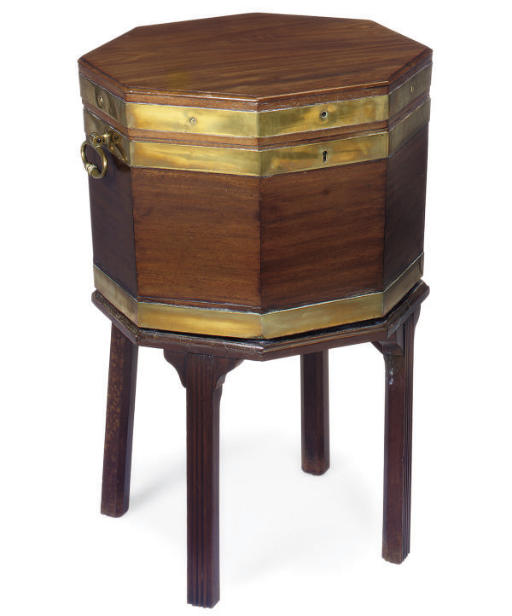 A GEORGE III MAHOGANY CELLERAT