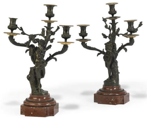 A PAIR OF FRENCH GILT AND PATINATED BRONZE FIGURAL THREE-LIGHT CANDELABRA