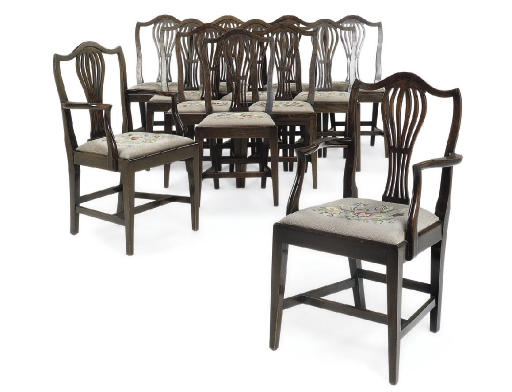 A SET OF TWELVE MAHOGANY DINING CHAIRS