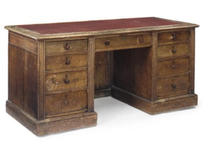AN EARLY VICTORIAN OAK KNEEHOL