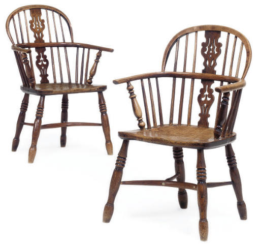 A NEAR PAIR OF NORTH EAST ASH AND ELM WINDSOR ARMCHAIRS