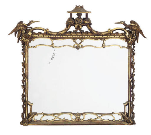 A GILTWOOD WALL MIRROR