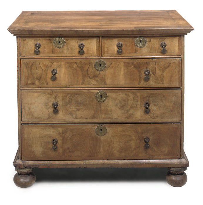 A figured walnut five drawer c