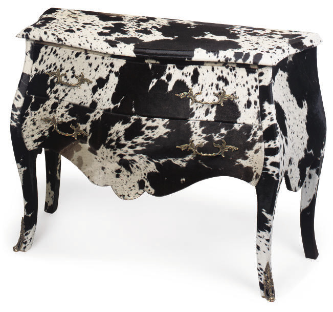 A COW HIDE UPHOLSTERED BOMBE C