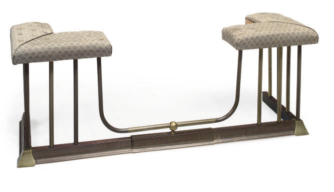 A BRASS AND UPHOLSTERED EXTEND