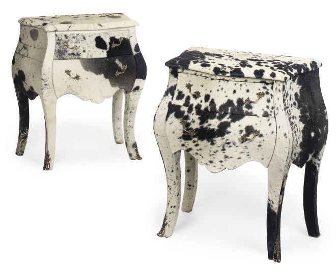 A PAIR OF COWHIDE UPHOLSTERED