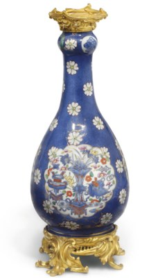 A Chinese clobbered bottle vas