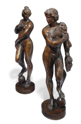 A PAIR OF CARVED WALNUT CLASSI