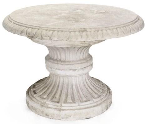 A COMPOSITE STONE GARDEN TABLE