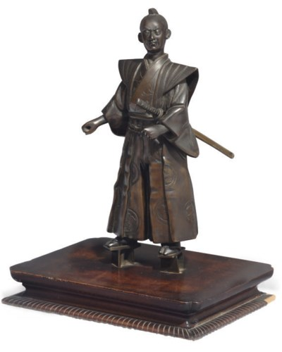 A Japanese bronze figure of a