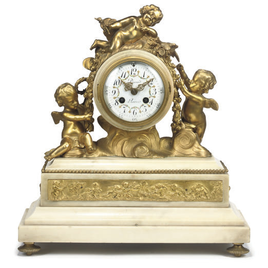 A WHITE MARBLE AND GILT BRONZE