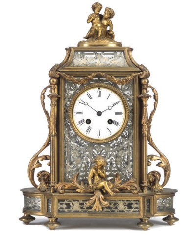 A FRENCH GILT-BRASS AND SILVER