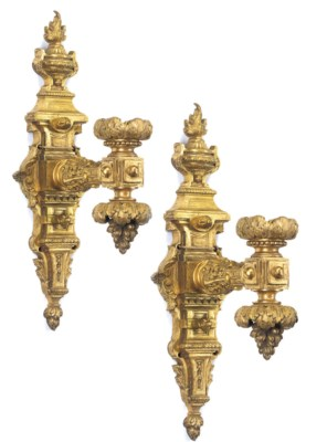 A SET OF FOUR GILT-BRASS WALL-