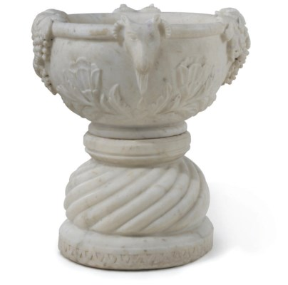 AN INDIAN WHITE-MARBLE URN ON