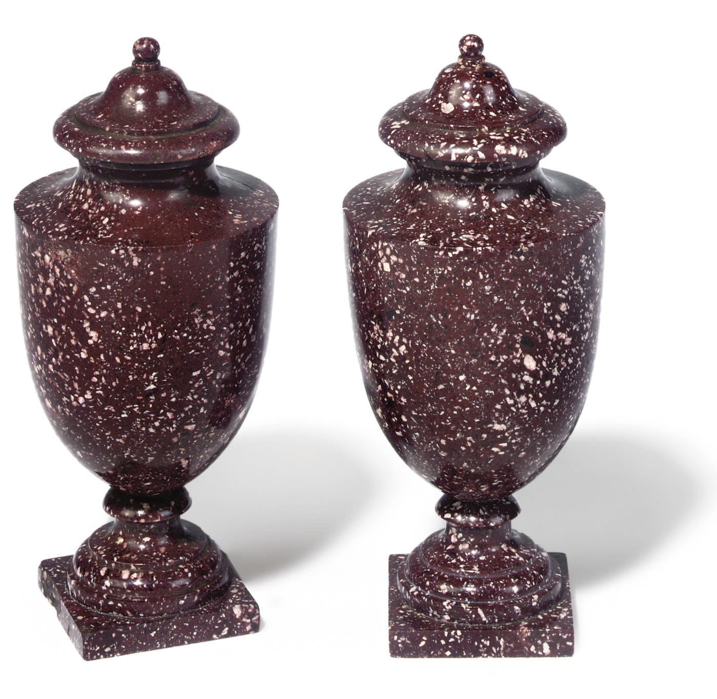 A PAIR OF PORPHYRY URNS