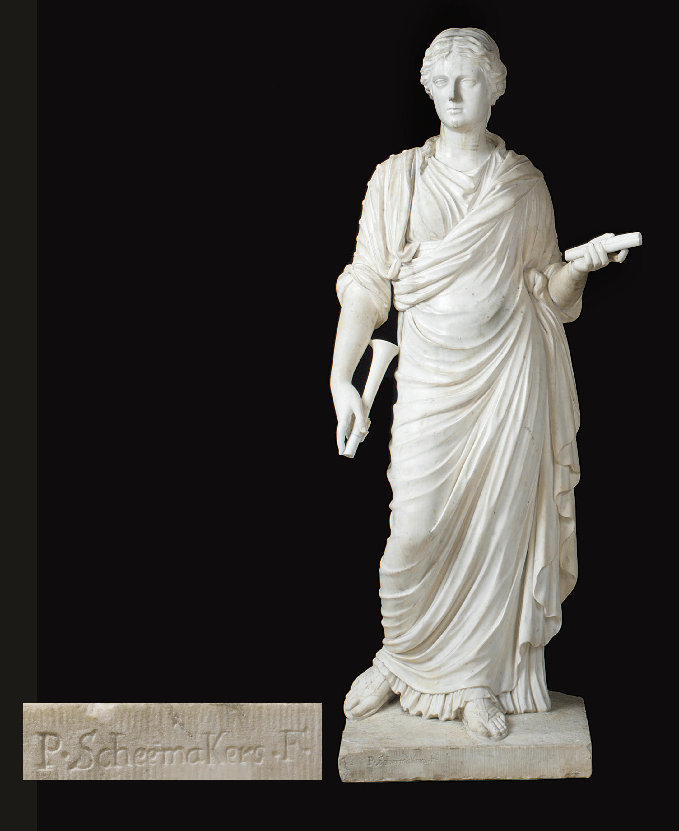 A WHITE STATUARY MARBLE FIGURE